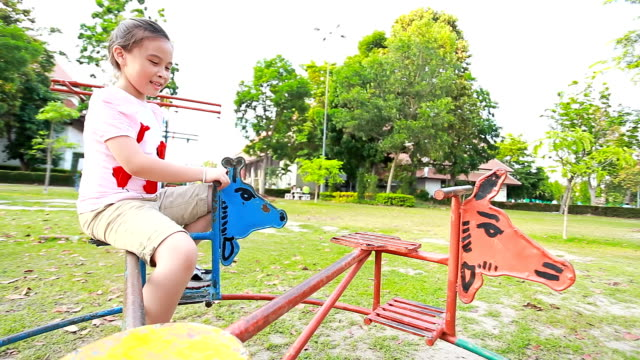 child girl on play equipment. - elementary school stock videos & royalty-free footage
