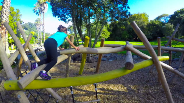 Child girl play on obstacle course