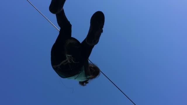 Child girl ride on flying fox