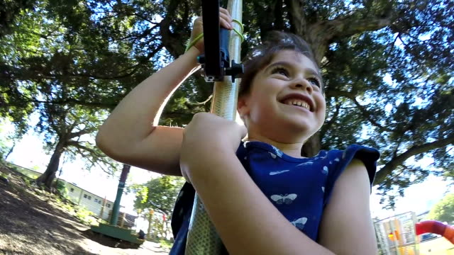 child girl rides on flying fox in the playground - carefree stock videos & royalty-free footage