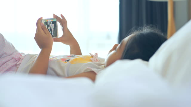child girl using technology social media on bedroom. - hanging up stock videos & royalty-free footage