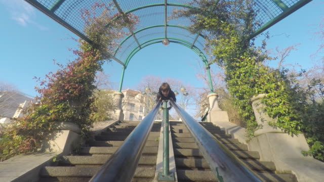 child goes down on a banister - 階段点の映像素材/bロール