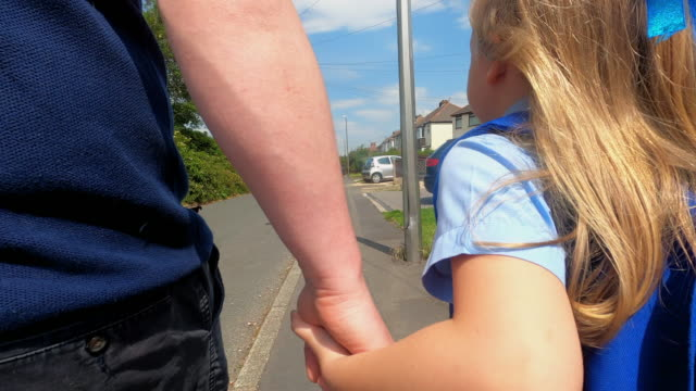 child going to school - holding hands stock videos & royalty-free footage
