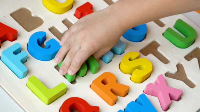 child hand playing alphabet puzzle. - the alphabet stock videos & royalty-free footage