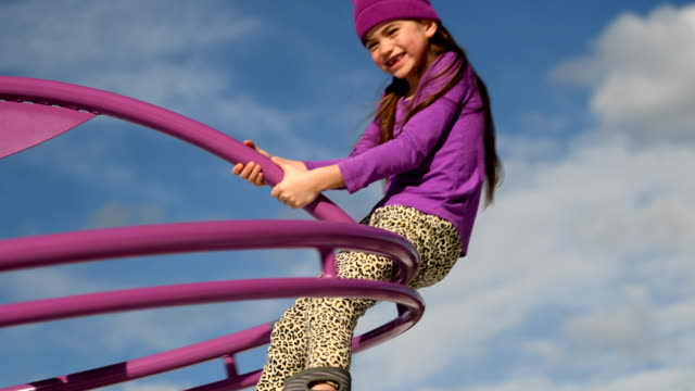 child having fun at a public playground - girls stock videos & royalty-free footage
