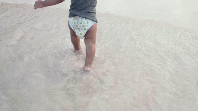 child having fun at the beach. - footprint stock videos & royalty-free footage