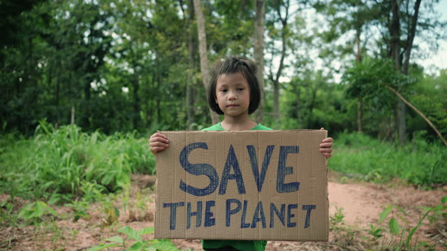 """child holding a sign with the message """"save the planet"""" - protection stock videos & royalty-free footage"""
