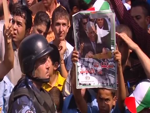 a child holds a poster of palestinian leader mahmud abbas in the middle of a crowd supporting the request to the united nations to admit palestine as... - poster stock videos & royalty-free footage