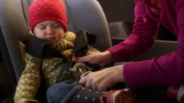 a child in a car safety-seat sweden. - seatbelt stock videos and b-roll footage