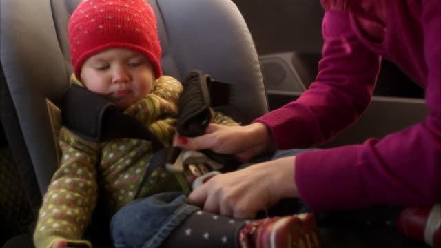 a child in a car safety-seat sweden. - schweden stock-videos und b-roll-filmmaterial
