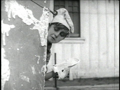 b/w 1920 child in chef's hat looking around corner / pies get thrown into his face / short - peeking stock videos & royalty-free footage
