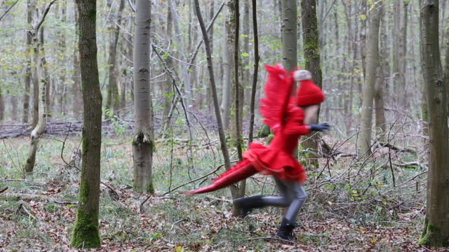 child in red dragon costume running through woods - tail wing stock videos and b-roll footage