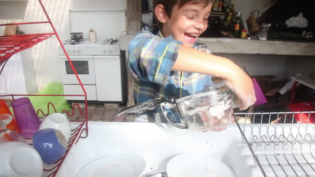 child is doing the dishes - housework stock videos and b-roll footage