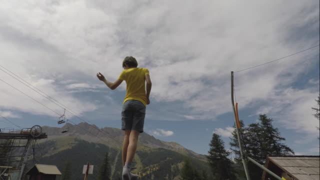 stockvideo's en b-roll-footage met child is doing trampoline - trampoline