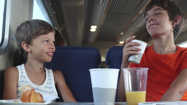 child is having breakfast on the train - disposable stock videos and b-roll footage