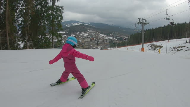 a child is skiing on a ski slope. - occurrence stock videos & royalty-free footage