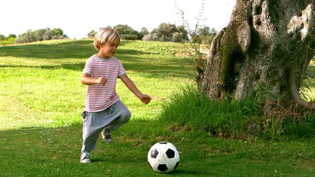 Child kicking a ball