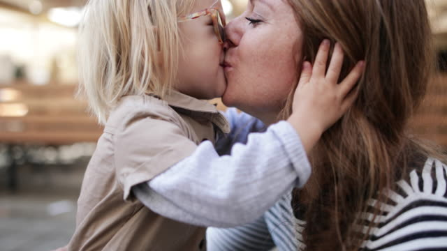child kissing mother - mother and daughter making out stock videos & royalty-free footage