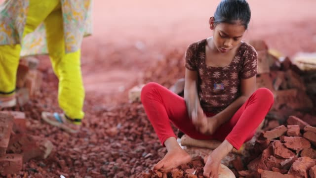 Child labor break bricks in Dhaka Bangladesh on March 06 2018 With over half of the population living below the poverty line women and children are...