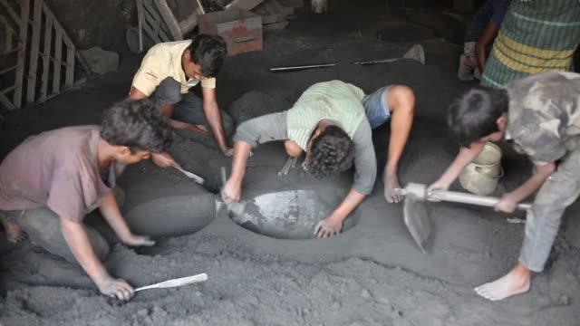 vídeos de stock, filmes e b-roll de child labourers work inside the propeller making factory without any safety gear, sometimes shoeless, without gloves or protective eyewear and right... - estilo de vida insalubre