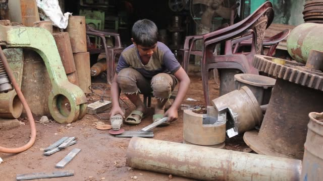 child labourers work inside the propeller making factory without any safety gear, sometimes shoeless, without gloves or protective eyewear and right... - {{relatedsearchurl(carousel.phrase)}} video stock e b–roll