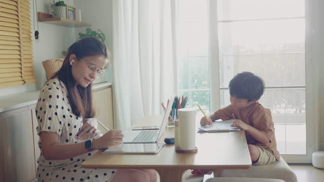 child learning at home with mother work from home - dining room stock videos & royalty-free footage