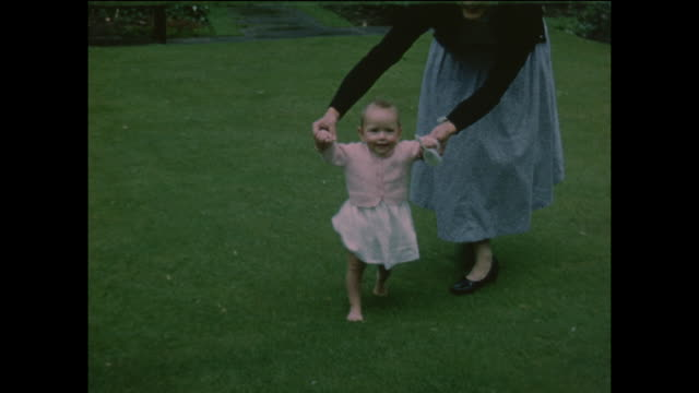 child learning to walk home movie footage circa 1960 - only girls stock videos and b-roll footage