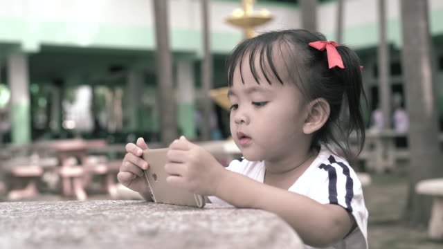 child looking on digital tablet - synthpop stock videos & royalty-free footage