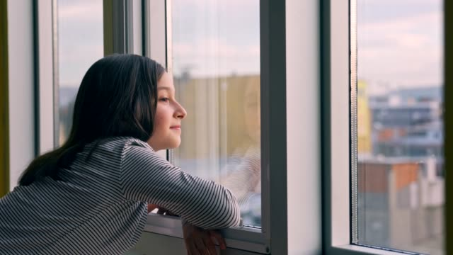 child looking out the window - innocence stock videos & royalty-free footage