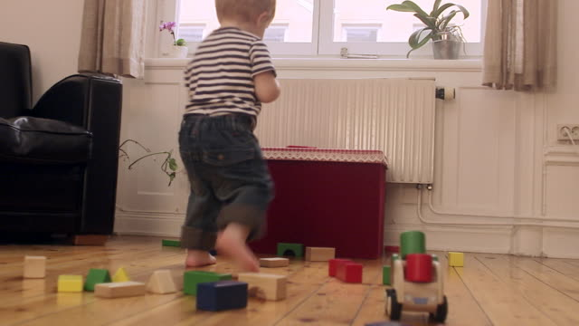 vidéos et rushes de a child looking out through a window sweden. - messy bedroom