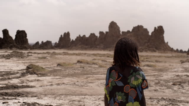 a child looks at scenery in the danakil depression, djibouti - horn of africa stock videos & royalty-free footage