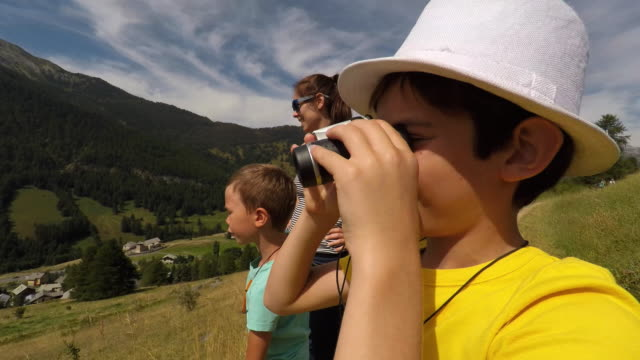 child looks in binoculars - binoculars stock videos & royalty-free footage