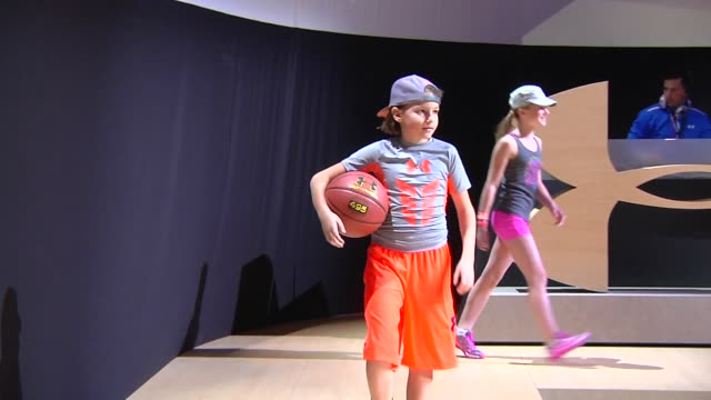 Child models wear Under Armour clothing during an Under Armour fashion show at Vanderbilt Hall in Grand Central Station in New York A white male...