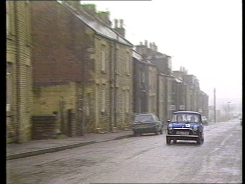 child murder suspect to be charged; leeds: morley gv street of terraced houses r-l shop - leeds stock videos & royalty-free footage