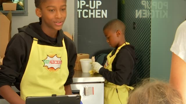 child of 11 opens pop up vegan restaurant in croydon croydon london uk omari mcqueen interview laqarn mcqueen working behind counter and interview... - sticker stock videos and b-roll footage
