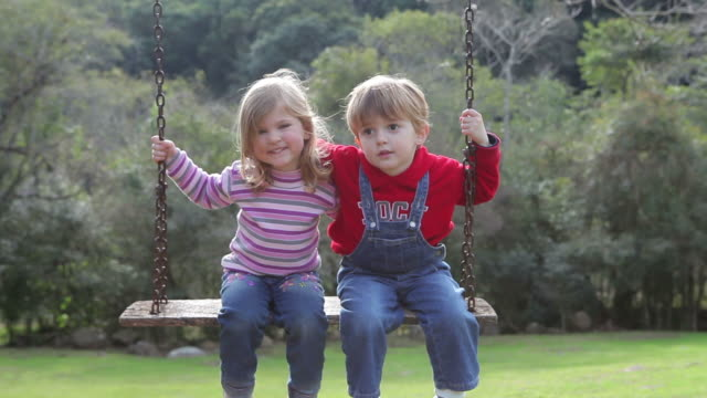 child on the swing - dungarees stock videos and b-roll footage