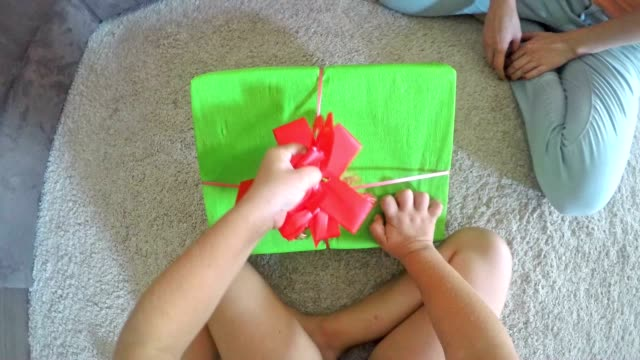 pov child opening a birthday present - unwrapping stock videos and b-roll footage