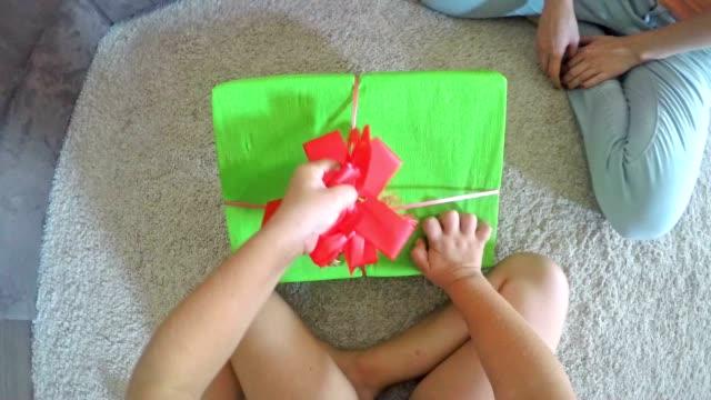 POV Child opening a birthday present