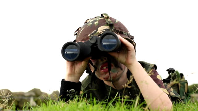 Child playing as an army soldier - with binoculars