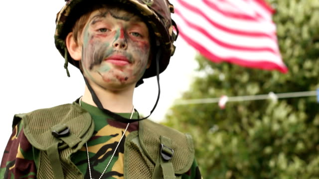 child playing as army soldier - saluting usa flag - saluting stock videos and b-roll footage