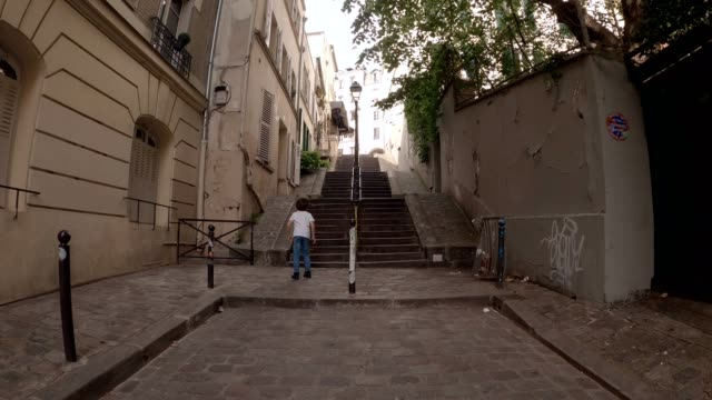 child playing ball alone in montmartre during the coronavirus lockdown - solitude stock videos & royalty-free footage