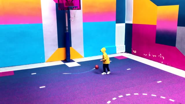 child playing basketball at pigalle colorful playground - multi coloured stock videos & royalty-free footage