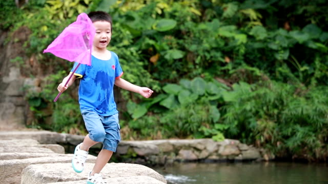 child playing by a stream fishing - catch of fish stock videos & royalty-free footage