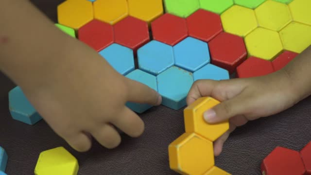 child playing colored puzzle wooden block - mosaic stock videos & royalty-free footage