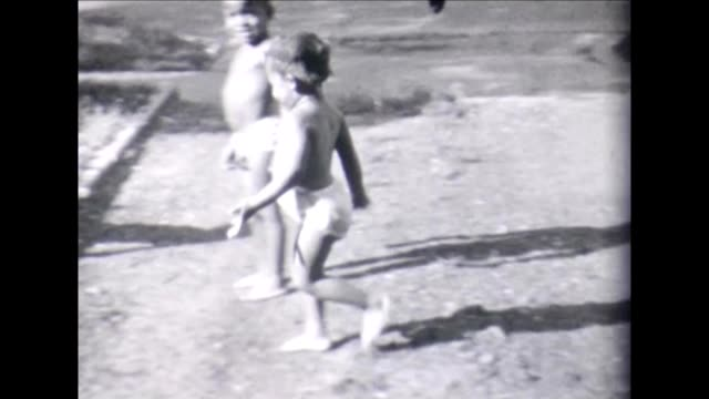 1955 child playing in sprinkler - bloomers stock videos & royalty-free footage