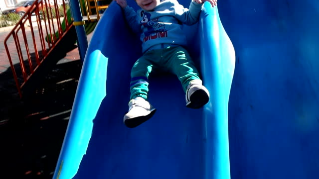 child playing in the park at playground - children only stock videos & royalty-free footage