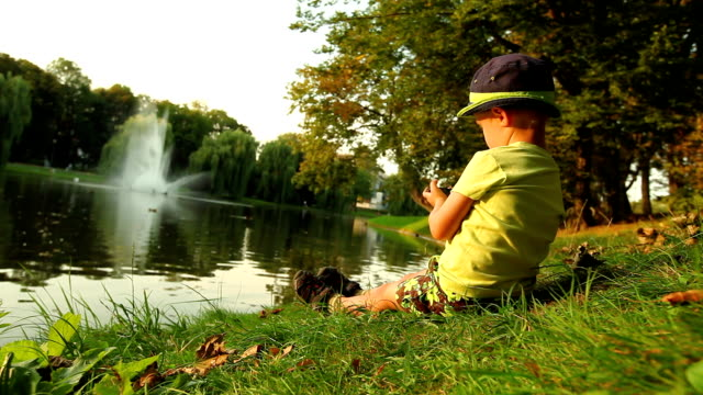 child playing in the park smartphone - handheld video game stock videos & royalty-free footage