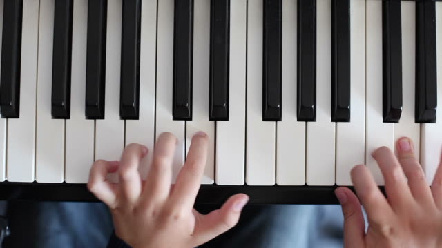 child playing on a piano - piano stock videos and b-roll footage