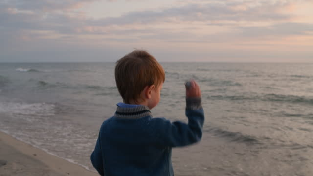 child playing on the beach in summer or autumn in sunset - only boys stock videos & royalty-free footage