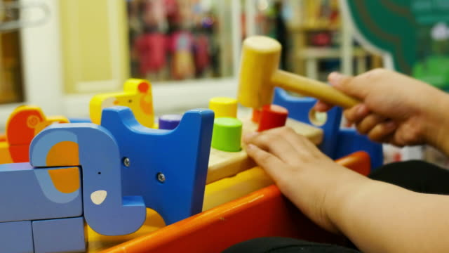 child playing toy , close up - child care stock videos & royalty-free footage